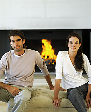 Couple sitting by fire image